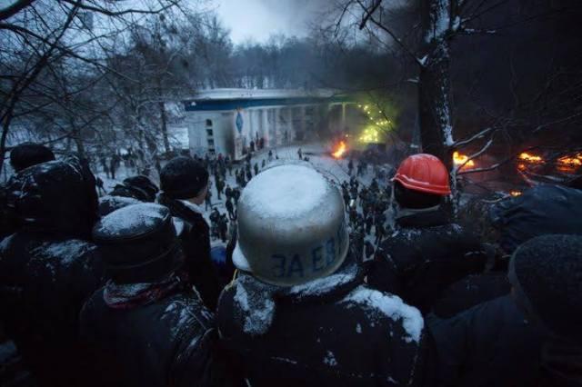 At Dynamo stadium on Hrushevskoho, smoke billows.