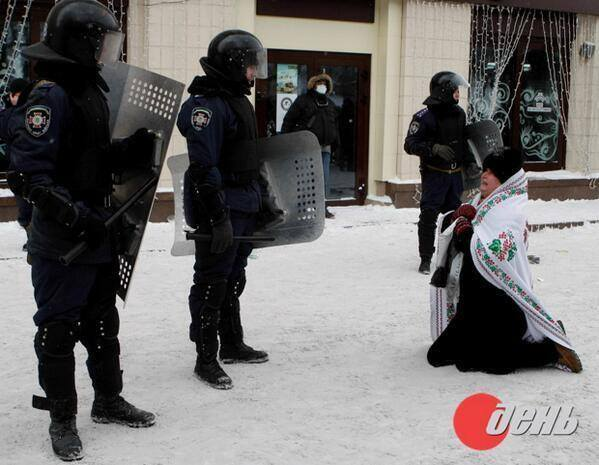 Police Forces beat grandmother Valya Bilan, seen here pleading with them to shoot her and not another old man, so they did, beat her for sport...