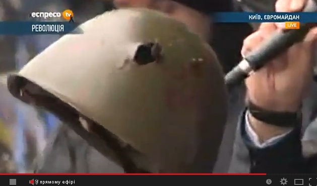 Helmet of a dead protester, perforated by bullet