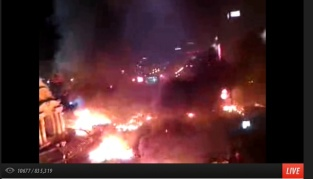 20:50 - Protesters attacking armored vehicle set it on fire