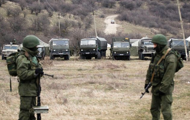 Military vehicles, believed to be property of Russian army, are seen near the territory of a Ukrainian military unit in the village of Perevalnoye outside Simferopol March 2, 2014.  Image by: VASILY FEDOSENKO / REUTERS