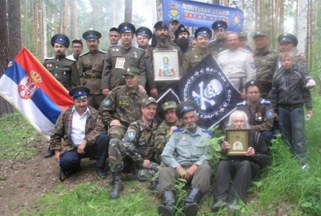 Milutin Malisic (center, holding icon) with his cossacks