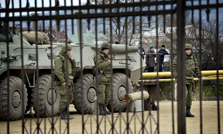 The Ukrainian marine base in Feodosia, Crimea, surrounded by Russian soldiers. Photograph: Rex Features.