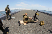 Insurgents took firing positions on the airport roof