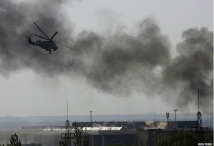 Ukrainian helicopters fires at insurgents inside the airport terminal