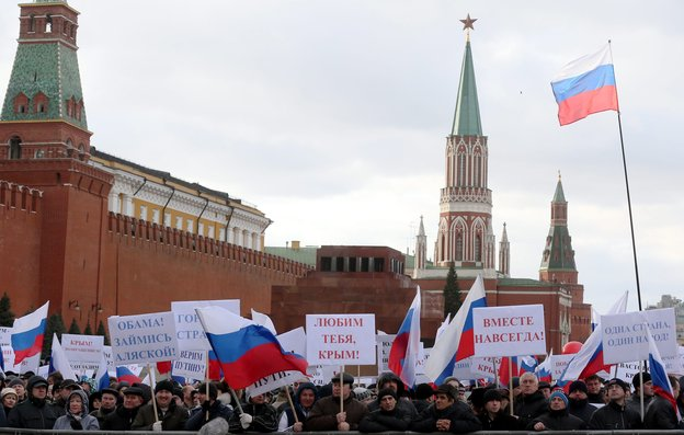 """Russians in Moscow's Red Square hold banners reading, """"Love You Crimea!"""" """"Together For All Time"""" and """"Obama, Think About Alaska!"""" during a March 18 rally celebrating the annexation of Crimea. Photo: Sergei Ilnitsky/EPA/Landov"""