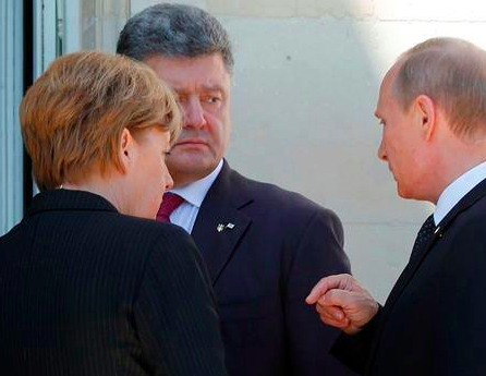 L to R: German Chancellor Angela Merkel, Ukrainian President-elect Petro Poroshenko and Russian President Vladimir Putin talk after a group photo during the 70th anniversary of the D-Day landings in Benouville, Normandy. Photo: REUTERS.