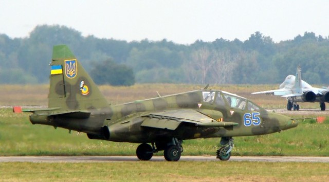 Ukrainian Air Force Su-25UB with two MiG-29s 9-13 in background