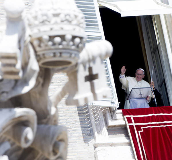 Pope Francis is pictured during his weekly Angelus prayer Aug. 24 from his window overlooking St. Peter's Square at the Vatican. (CNS/EPA)