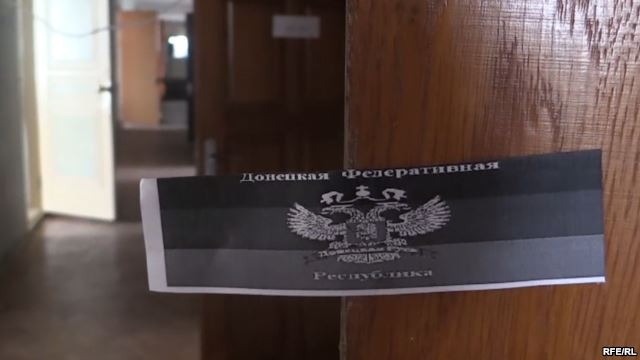 In the City Council of Sloviansk, the former headquarters of the separatists, after it was liberated by Ukrainian troops.