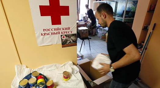 Ilya Naymushin   Reuters Employees of a small private company sort items to be distributed to victims of the crisis in eastern Ukraine at a collection point in Krasnoyarsk, July 3, 2014. The humanitarian aid is being collected in cooperation with the regional office of the Russian Red Cross.