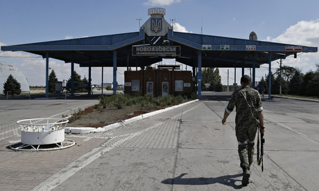 A Russian terrorist walks at the Novoazovsk border crossing point, in eastern Ukraine. Photograph: Sergei Grits/AP