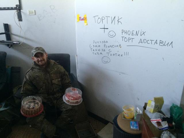 "On the wall: ""Phoenix delivered cake"" and a birthday wish for one of them."
