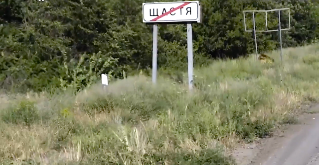 Leaving Shchastya road sign (shchastya means happiness)