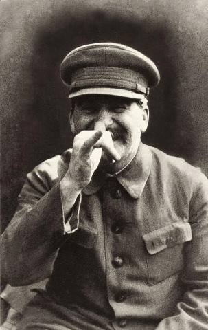 Stalin thumbing off his bodyguard, Lt. Gen. Nikolai Vlasik, who took this photo. Date unknown.