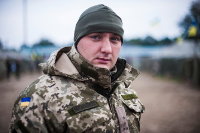 YAVORIV, Ukraine -- Lt. Yevgen Zabrodsky stands for a portrait at the International Security and Peacekeeping Center here, 25 September 2014. Zabrodsky, a Marine officer in the Ukraine military and native of Kharkiv, Ukraine, was stationed at the Ukrainian Naval Headquarters in Crimea when Russian forces invaded early this year. He and his unit were barricaded inside the headquarters installation for weeks more than a month before Ukraine withdrew military personnel from the peninsula. Crimea has since voted to separate from Ukraine and has been annexed by the Russian Federation in a move largely condemned by the international community.