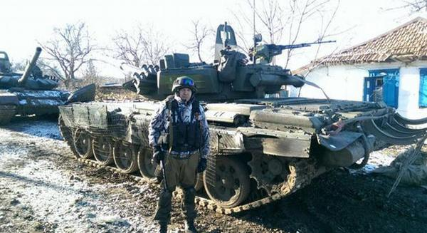 A hardworking tractor driver brought his tractor T-72b3 directly from Russia to plow in Debaltseve (Source