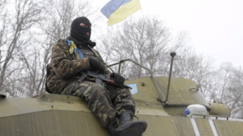 Ukrainian soldier makes it out of Debaltseve somewhat shellshocked.