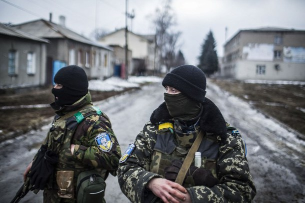 Ukrainian Army soldiers patrol the empty streets of Debaltseve, in the Donetsk region, on February 3, 2015. AFP PHOTO / MANU BRABO