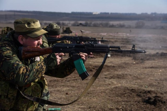 Pro-Russian rebels participate in a military training exercise near Yenakiyeve, in the Donetsk region of eastern Ukraine, in March 2015. Mstyslav Chernov / AP photo. Source.