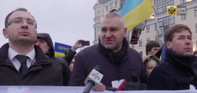 Savchenko defense team lawyers Nikolai Polozov (L) and Ilya Novikov (R) flank Mark Feygin at March 1, 2015 Nemtsov/Savchenko rally in Moscow.