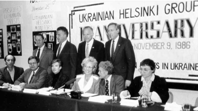 Press conference on the tenth anniversary of the Ukrainian Helsinki Group, Vienna, 1986. Left to right, seated: Leonid Plyushch, Tomas Venclova, Ginte Damusis, Christina Isajiw, Yuri Orlov, Nadiia Svitlychna. Standing: Sam Wise, deputy director CSCE Commission; Senator Paul Sarbanes; Senator Dennis DeConcini; Congressman Steny Hoyer, chairman CSCE Commission.