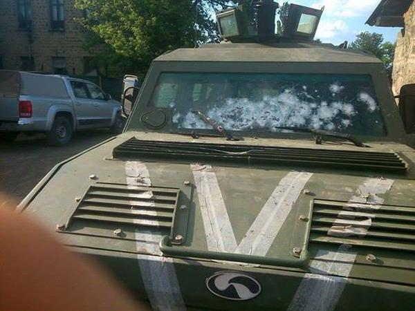"Ukrainian APC ""Cougar"" managed to withstand this many precise shots to its bulletproof windshield during separatist ambush. Source"