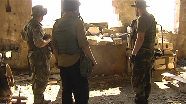 Ukrainian soldiers at Putilov mine, Avdiivka, survey shelling damage. Source: http://uatoday.tv/politics/east-ukraine-fronline-sniper-fire-rocket-shelling-continues-near-avdiivka-459104.html