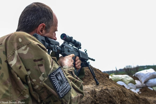 An Azov Battalion sniper takes aim on the front line. Photo: Noah Brooks. Source: https://twitter.com/NoahBrooks99/status/625456092940734465