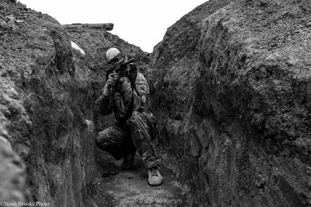 A sniper takes aim in Shyrokyne. Photo: Noah Brooks.