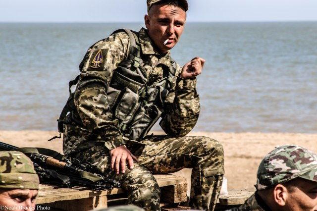 A Ukrainian soldier smoking on the beach in Mariupol. Just a few miles away, a battle was taking place as separatists tried to capture the city. Photo: Noah Brooks. Source: http://ink361.com/app/users/ig-938895707/modernwarcollective/photos/ig-1038982617997447827_938895707