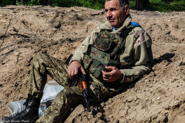 Ukrainian military serviceman, on a break between firefights. Photo: Noah Brooks