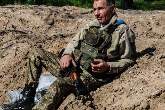 Ukrainian military servicemen, on a break between firefights. Photo: Noah Brooks