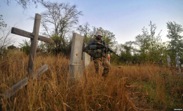 "Ukrainian soldier patrolling a section of the ""gray zone"" (neutral territories). Donetsk oblast, October 1, 2015. Source: http://www.radiosvoboda.org/media/photogallery/27214013.html"