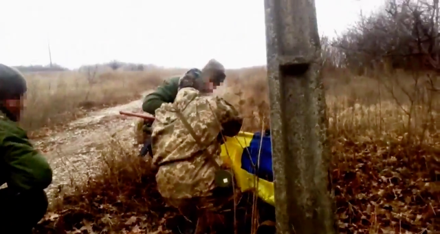 Ukrainian soldier raises flag in occupied Zaitseve, Ukraine on his birthday, Feb 9. Source: (Screenshot from video)