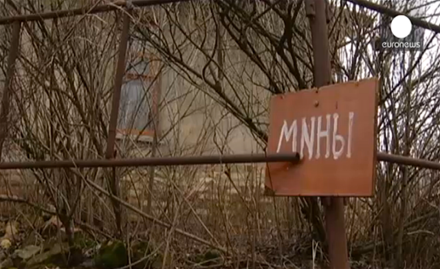 Sign warning about mines in Donbas.
