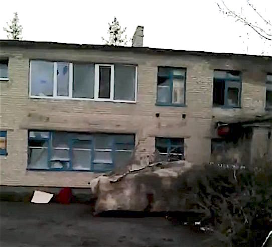 Putin's orcs hide a BMP beneath the wall of a school turned into a stronghold base in Zaitseve, March 17, 2016. (2/2) Photo.