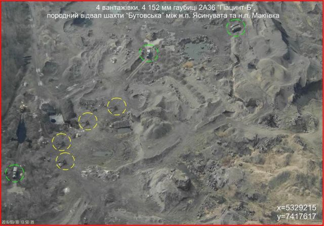 "March 31, 2016 photo of Russian firing positions near Avdiivka, at Butovka mine. ""Four trucks, four 152 mm howitzer 2A36 Giatsint-B. Butovska mine slag heaps inbetween the settlements of Yasynuvata and Makiivka. Photo: ATO Press Center https://www.facebook.com/ato.news/photos/pcb.1176613312349473/1176612459016225/?type=3&theater"
