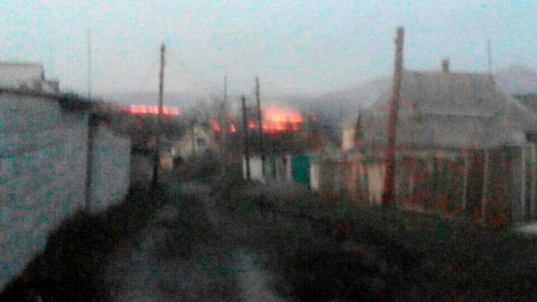 "Several houses on fire in Mar'inka after Russian strikes on April 9, 2016. ""View from Lenin St."" Photo source: https://twitter.com/hyeva_maryinka/status/718895578718040065"