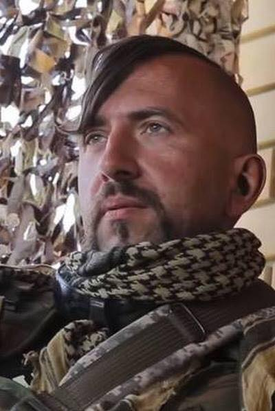 "Ukrainian-born Wassyl Slipak on the front line. His call sign was ""Mephistopheles"" a role he famously played, shortened to Миф/Meph meaning ""Myth"" in Ukrainian."