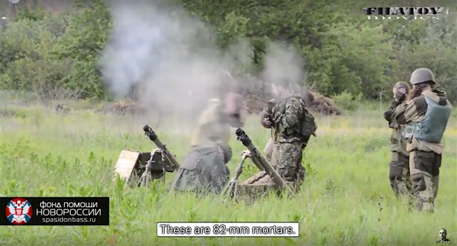 May 31st battle for Mar'inka. Russian proxy grenade launcher unit firing 82 mm mortars at Ukrainian positions 400 m away. Photo: social media video screenshot