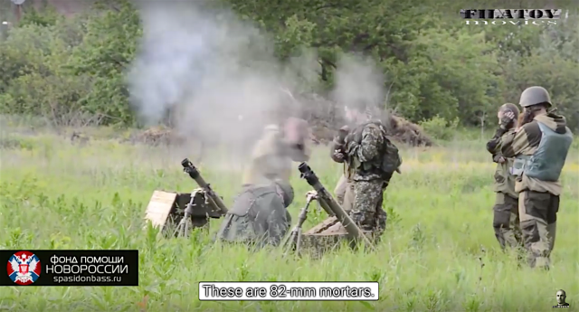 May 31st battle for Mar'inka. Russian proxy grenade launcher unit firing 82 mm mortars at Ukrainian positions 400 m away. Photo: social media video screenshot