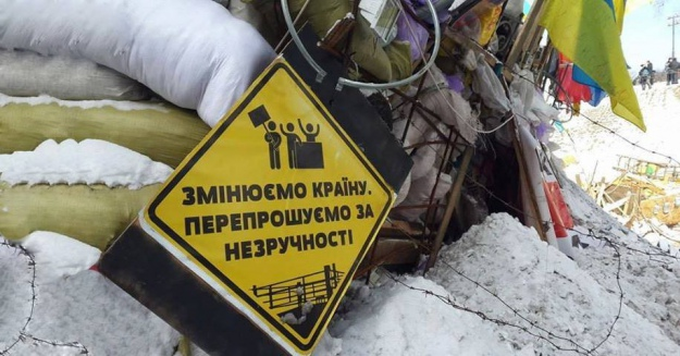 "Sign on barriers during Euromaidan protests 2014: ""We are changing the country. Sorry for the inconvenience."""
